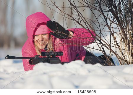 young girl with air rifle