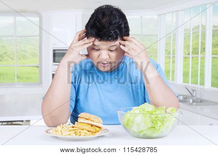 Confused Man To Choose Hamburger Or Salad
