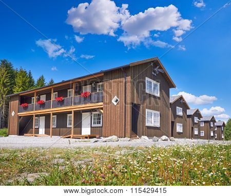 Coastal Wooden Houses In Norway In Summer Day