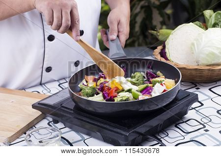Chef Cooking Stir Fried Vegetable