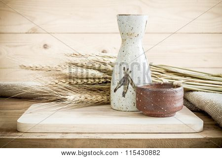 Japanese Sake Drinking Set On Wood Texture Background.