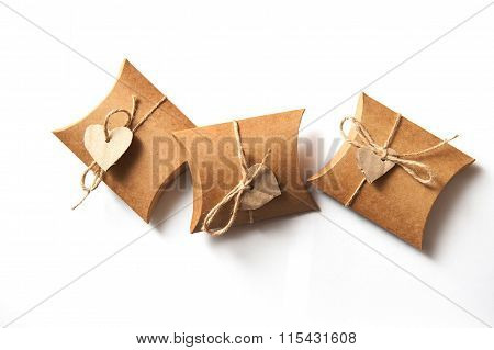 Beautiful Gifts Of Kraft Paper With A Heart On A White Background On Valentine Day