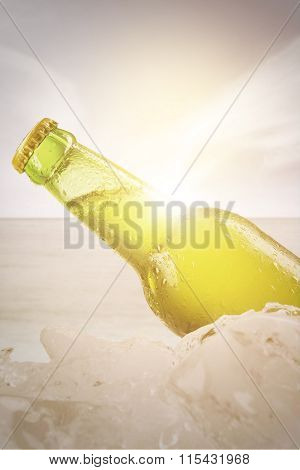 Fresh Beverage In The Bottle With Ice Cube
