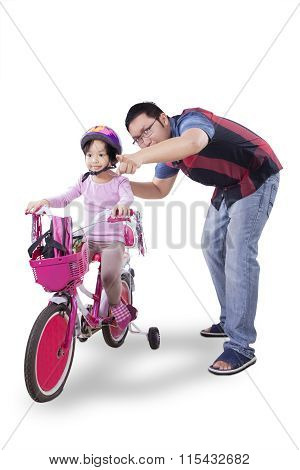 Girl Ride Bicycle With Her Father