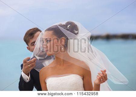 Beautiful newlyweds outdoor.