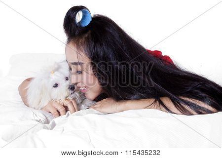 Happy Woman With Long Hair And Dog On Bed