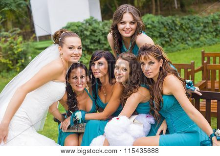 The bride and  bridesmaids in the garden.
