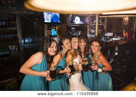 The bride and bridesmaids in the pub.