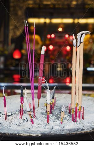 Incense Sticks With Ash In The Temple
