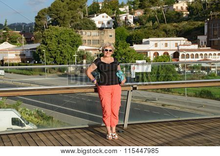 Aged Lady Is Standing On Footbridge In Santa Susanna, Spain.