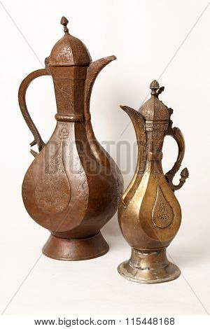 Two old wine jug on a white background
