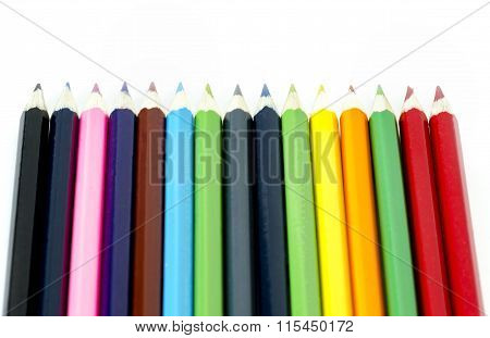 Many Colored Pencils Aligned On White Background