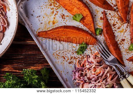 Homemade Cooked Sweet Potatoes With Coleslaw.