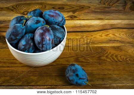 Plum Prunes In A White Cup