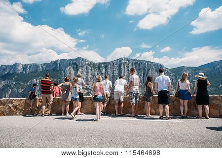 People look at mountains from lookout in Gorges Du Verdon in sou