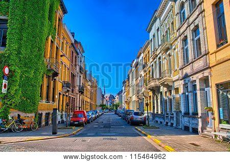 Shadow street in Antwerp, Belgium, Benelux, HDR