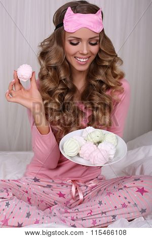 Sexy Beautiful Woman With Blond Curly Hair In Pajama With Sweets