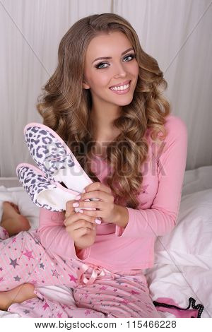 Sexy Beautiful Woman With Blond Curly Hair In Pajama With Slippers