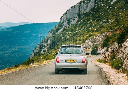 Gray colour Nissan Micra car on background of French mountain na
