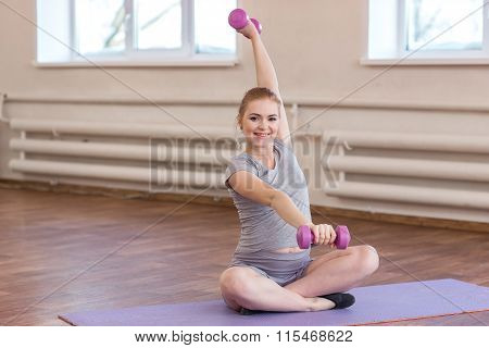 Young Pregnant Woman Doing Gymnastic Exercises