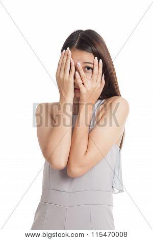 Beautiful Young Asian Woman Peeking Through Fingers