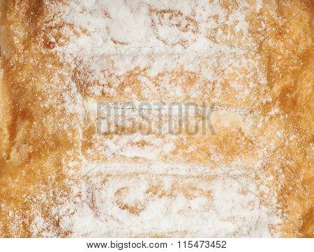 Sugar powder covered strudel bun
