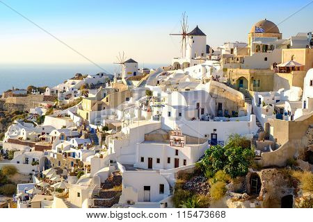 View Of Beautiful Village Oia With Whitewashed And Colorful Houses