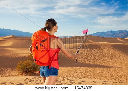 Portrait of woman with selfie stick, Death valley