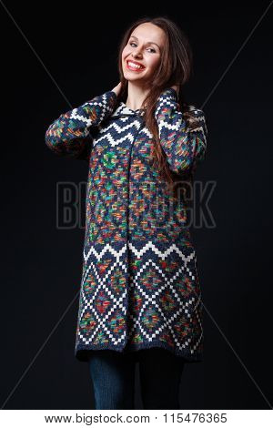 Attractive Woman In Bright Sweater Smiling