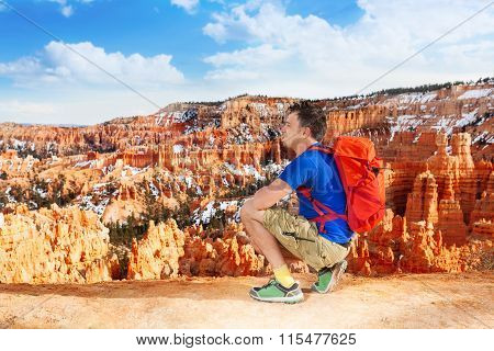 Hiker man take picture of Bryce canyon
