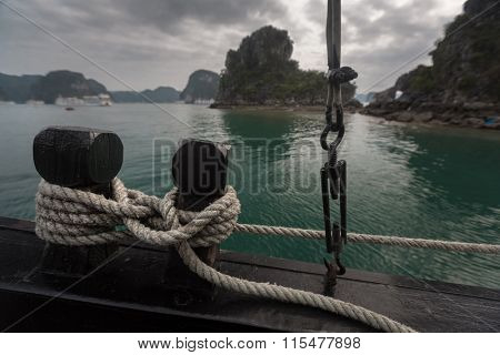 Rope coiled on the wooden boat