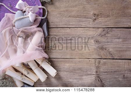 Valentine's day set: heart, pink ribbon and vintage scrolls on rustic driftwood background,