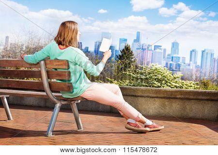 Woman read book in Seattle park