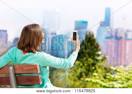Young woman take selfie with Seattle on background