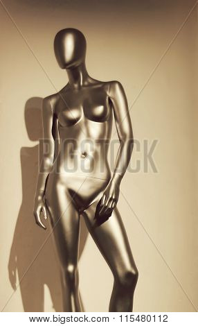Golden mannequin in the form of a sexy woman
