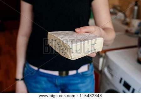 Woman Holding Brie Cheese