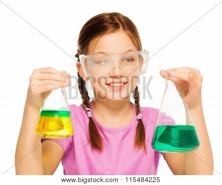 Pupil looking to results of her chemical tests