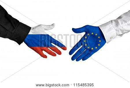 Russia and European Union leaders shaking hands on a deal agreement