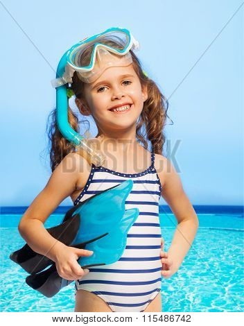 Smiling diver in stripped swimwear, summer day