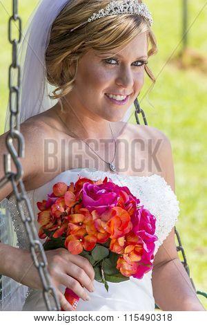 A modern bride posing in an outdoor environment