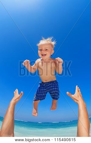 Father Throwing Up In The Air A Happy Child