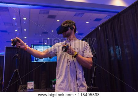 Man Tries Virtual Reality Headset And Hand Controls