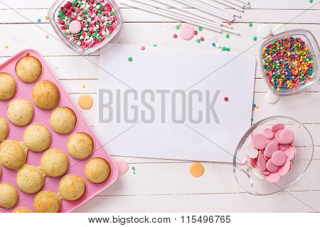 Ingredients For Cake Pops And Empty Tag  On White Wooden Background.