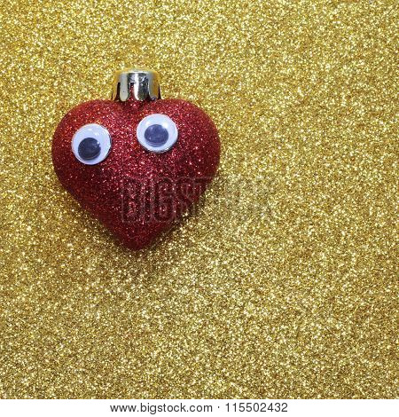 Lonely Red Heart With Big Eyes On The Golden Background Shiny