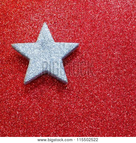 One Large Silver Star On Red Bright Background