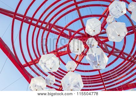 Ice Blocks Hanging From Red Metal Structure