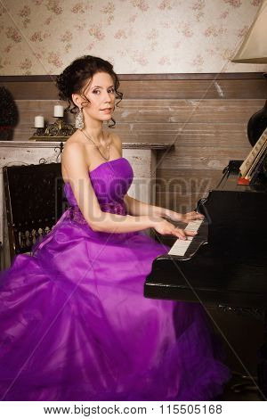Woman Dressed In Long Lace Dress Playing Piano