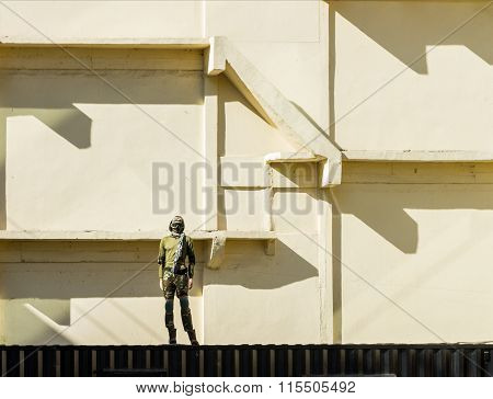 Soldier Standing With On The Wall Background.