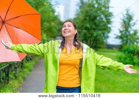Happy Young Woman Enjoying The Summer Rain In The Park