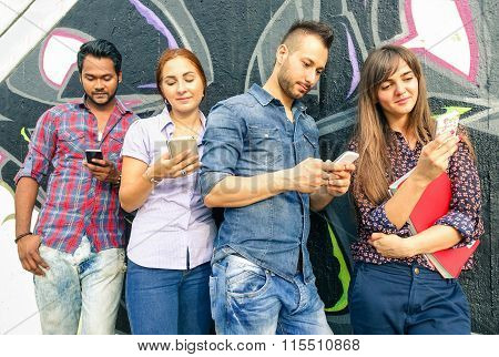 Group Of Friends With Mobile Sharing Sms Online - Multiracial Students Play With Cell Phone